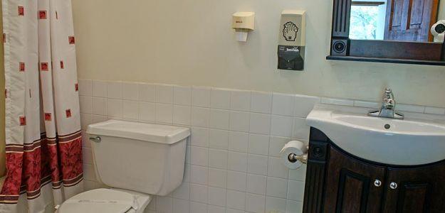 Hotel room bathroom and hand soap dispenser