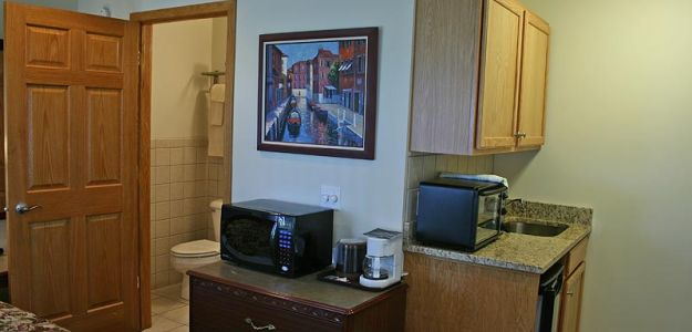 Hotel room with kitchen microwave and sink