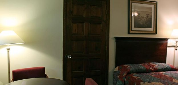 Hotel room with furniture and room door
