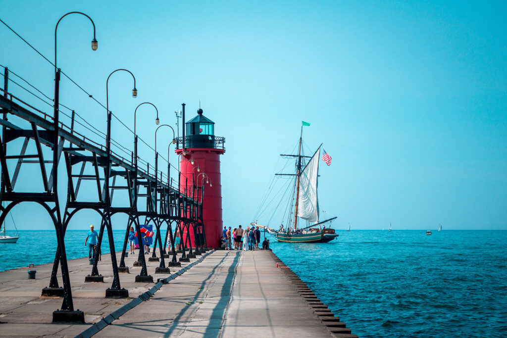 Lake Bluff Inn and Suites attractions light house with ship in the ocean
