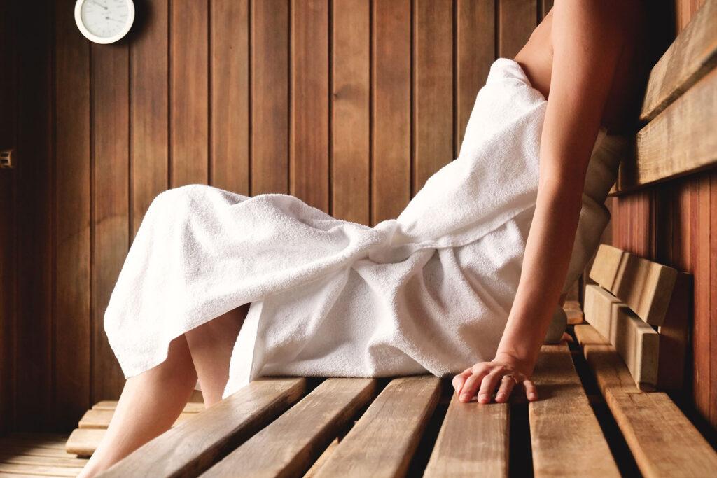 woman in towel using sauna