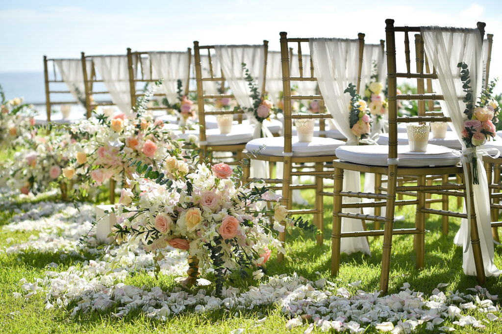 Wedding set up with chairs decorated with flowers and petals