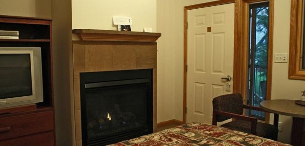 Hotel room with fire place