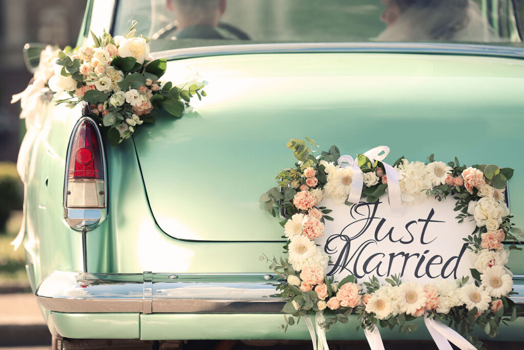 Lake Bluff Inn and Suites weddings bumper view of car with just married sign and flowers